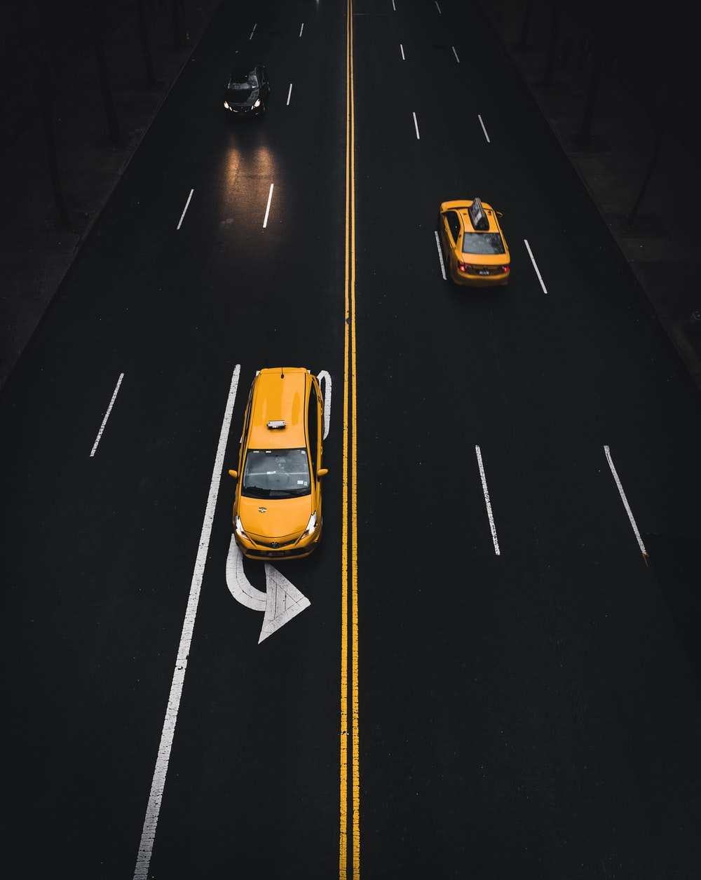 yellow SUV on road with left turn sign