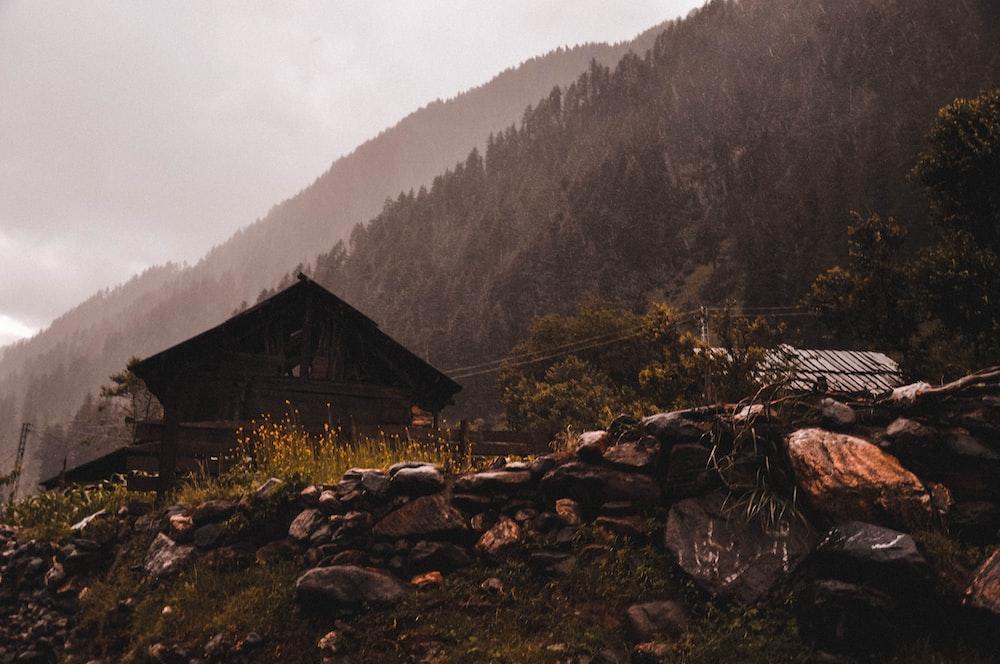 brown shack near mountain