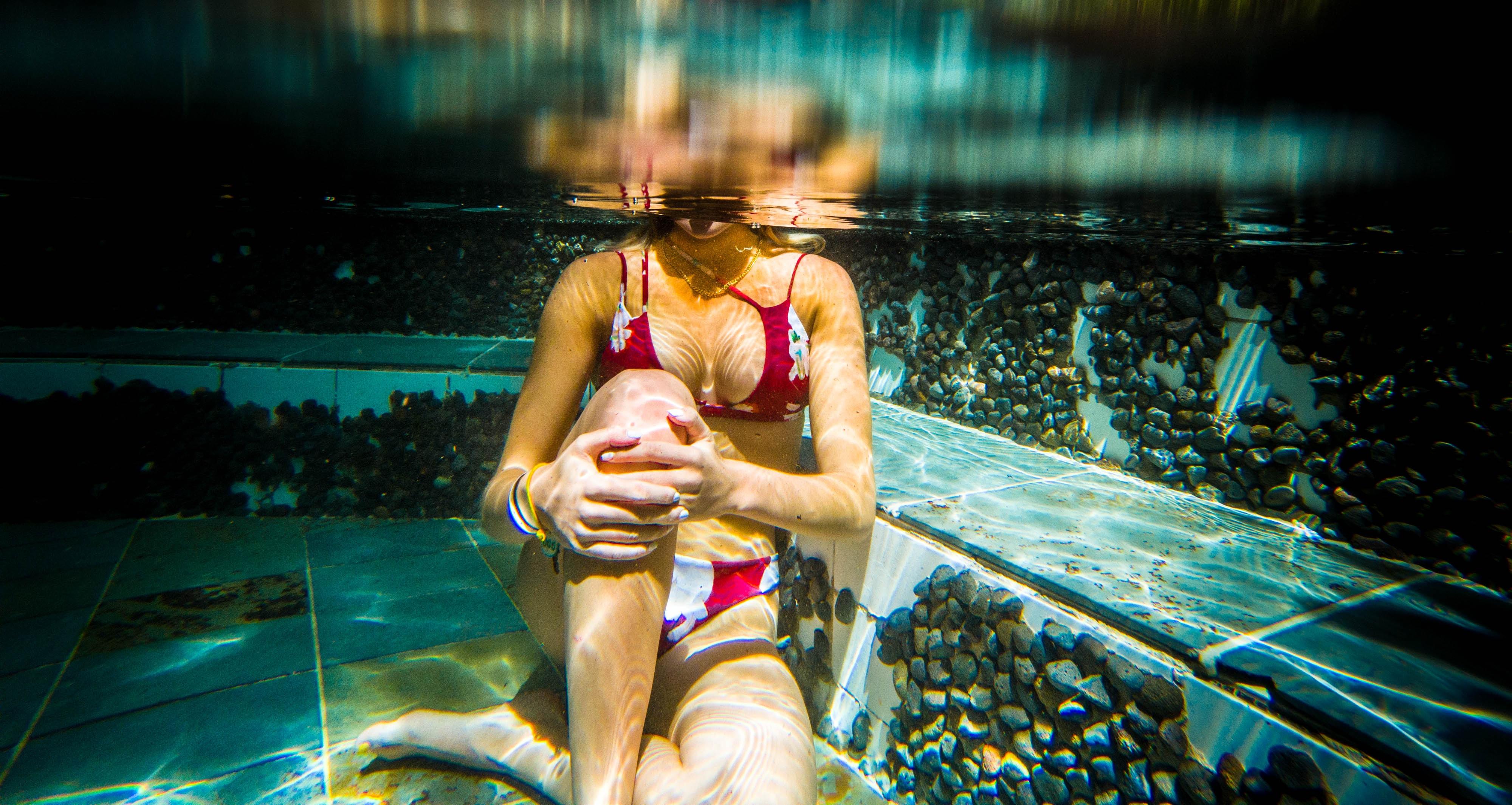 woman sitting underwater