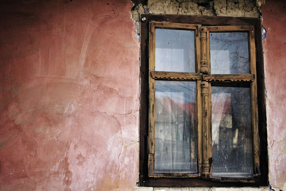 closed brown wooden framed glass door