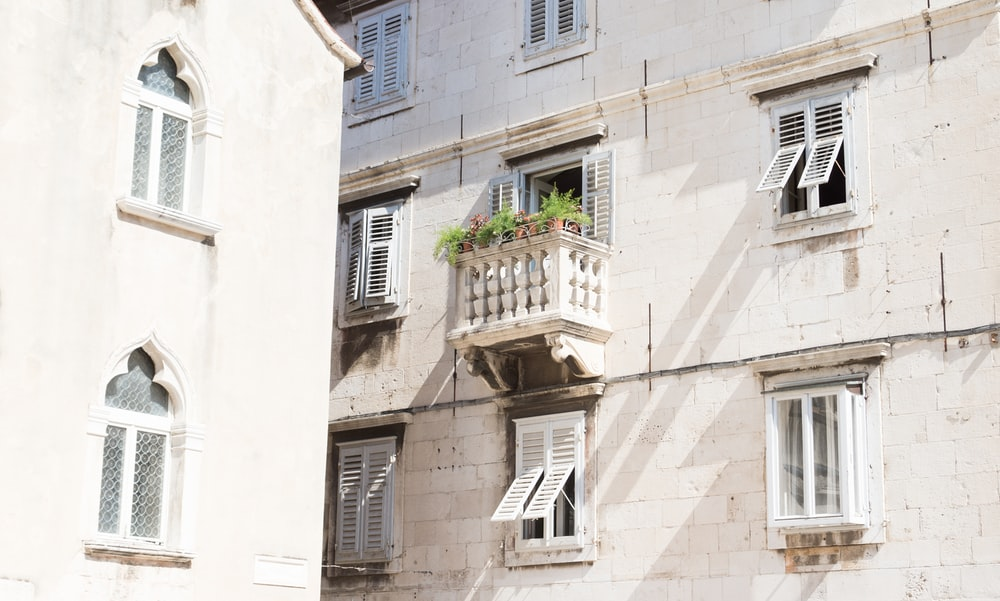green potted plant on brown concrete house balcony