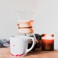 selective focus photo pf white mug