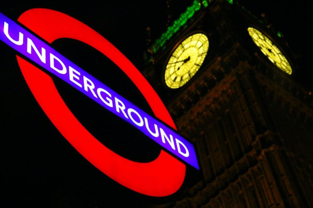 Underground neon signage beside Big Ben