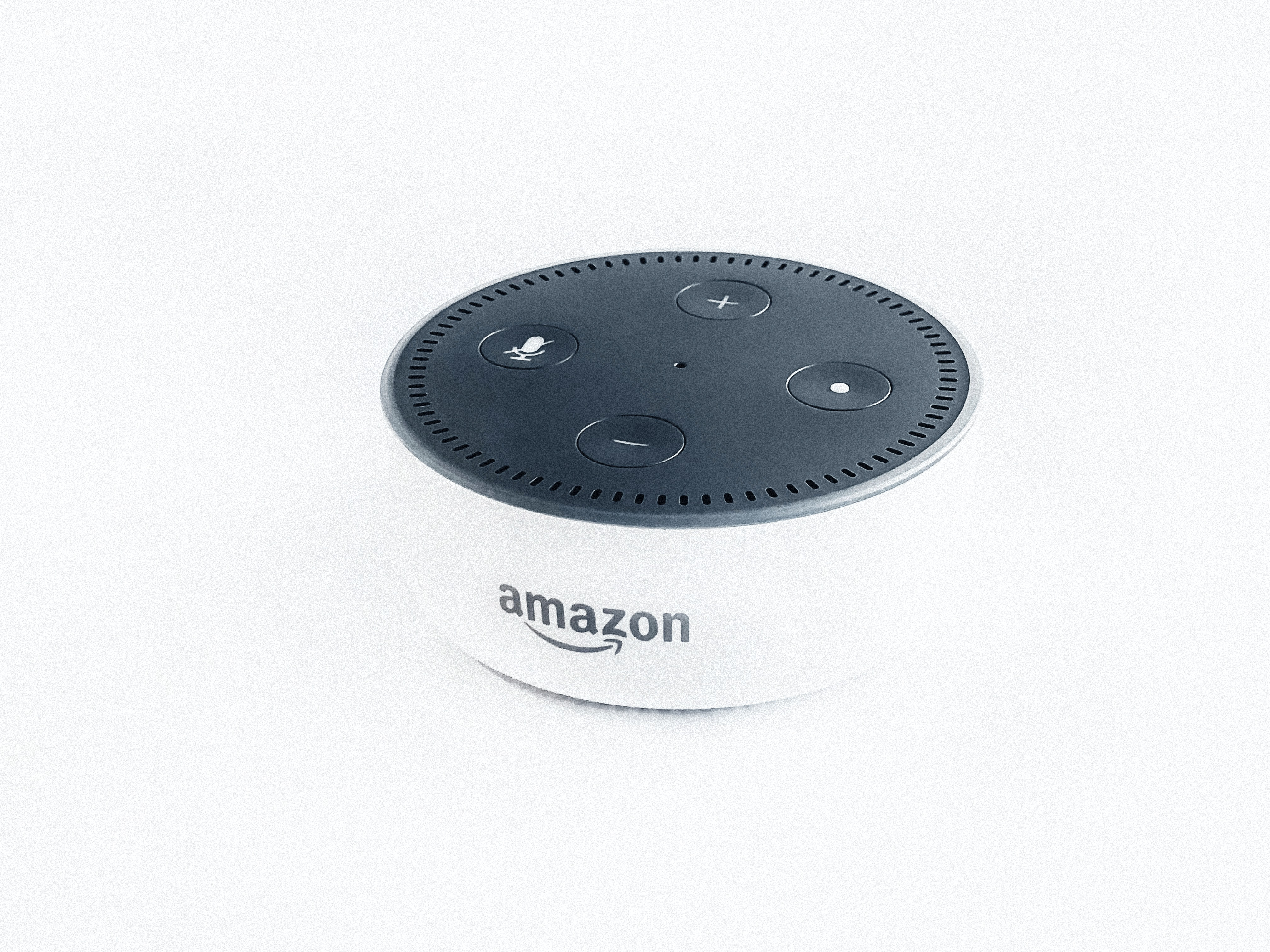 white and black Amazon Echo dot