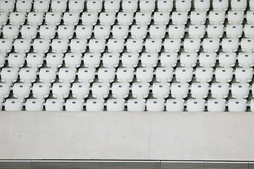 white seats with gray concrete platform