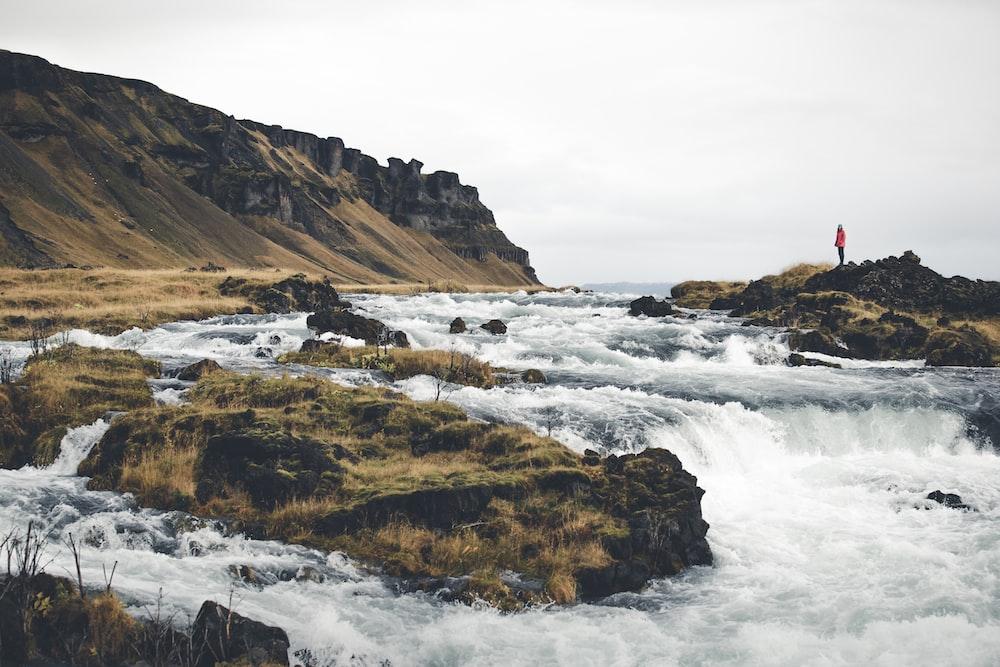 waterfalls near mountain at daytime
