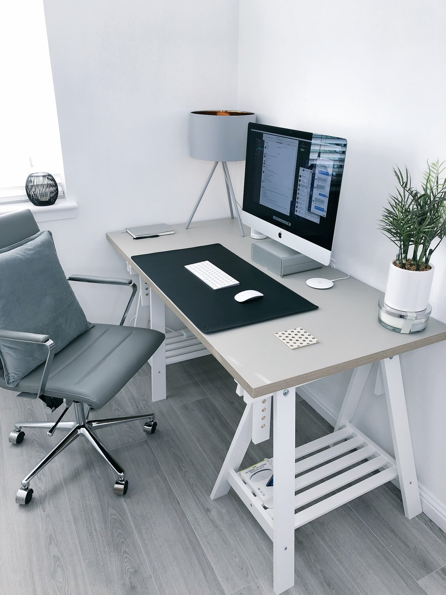 Gray Leather Office Rolling Armchair Beside White Wooden