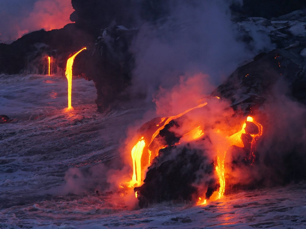 photo of lava flowing on land