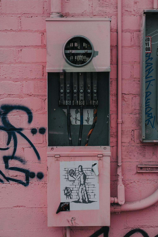 photography of distribution board with graffiti sticker
