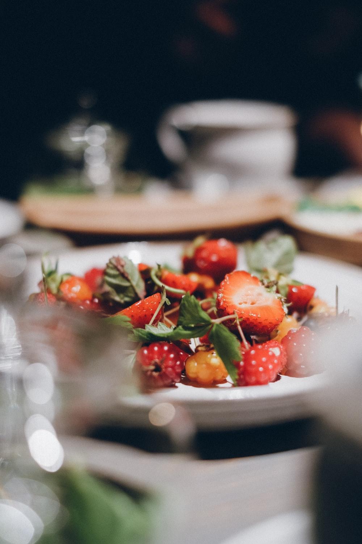 strawberries served on white ceramic plate