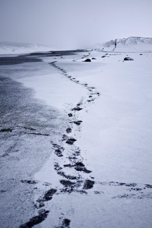photography of feet print on through mountain