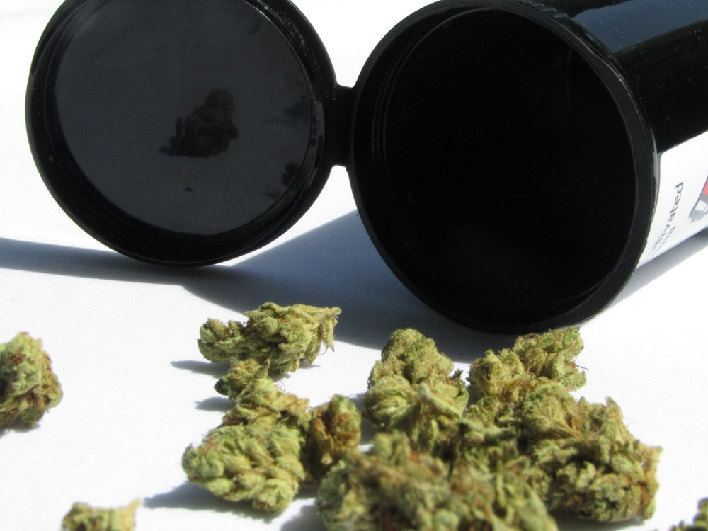 green kush with black container