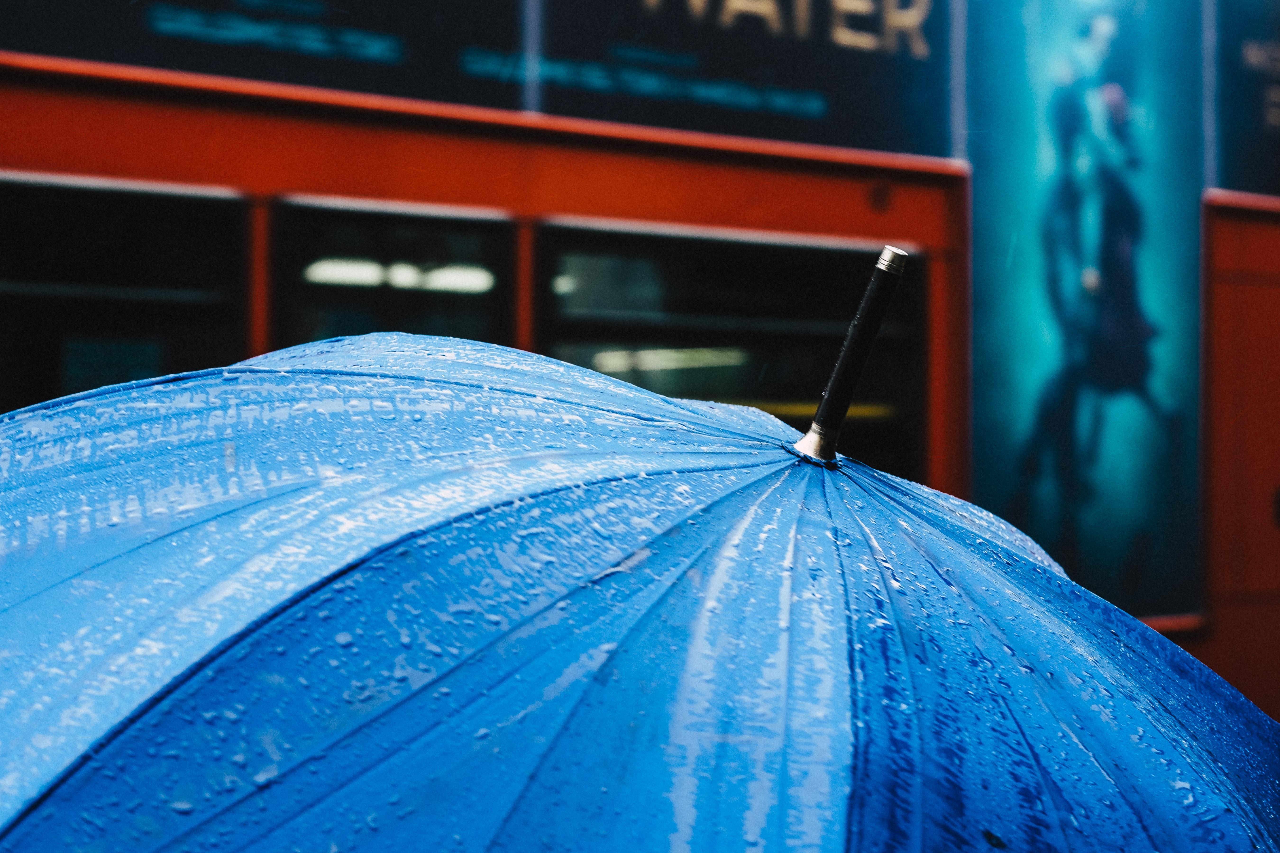 selective focus photography of blue umbrella