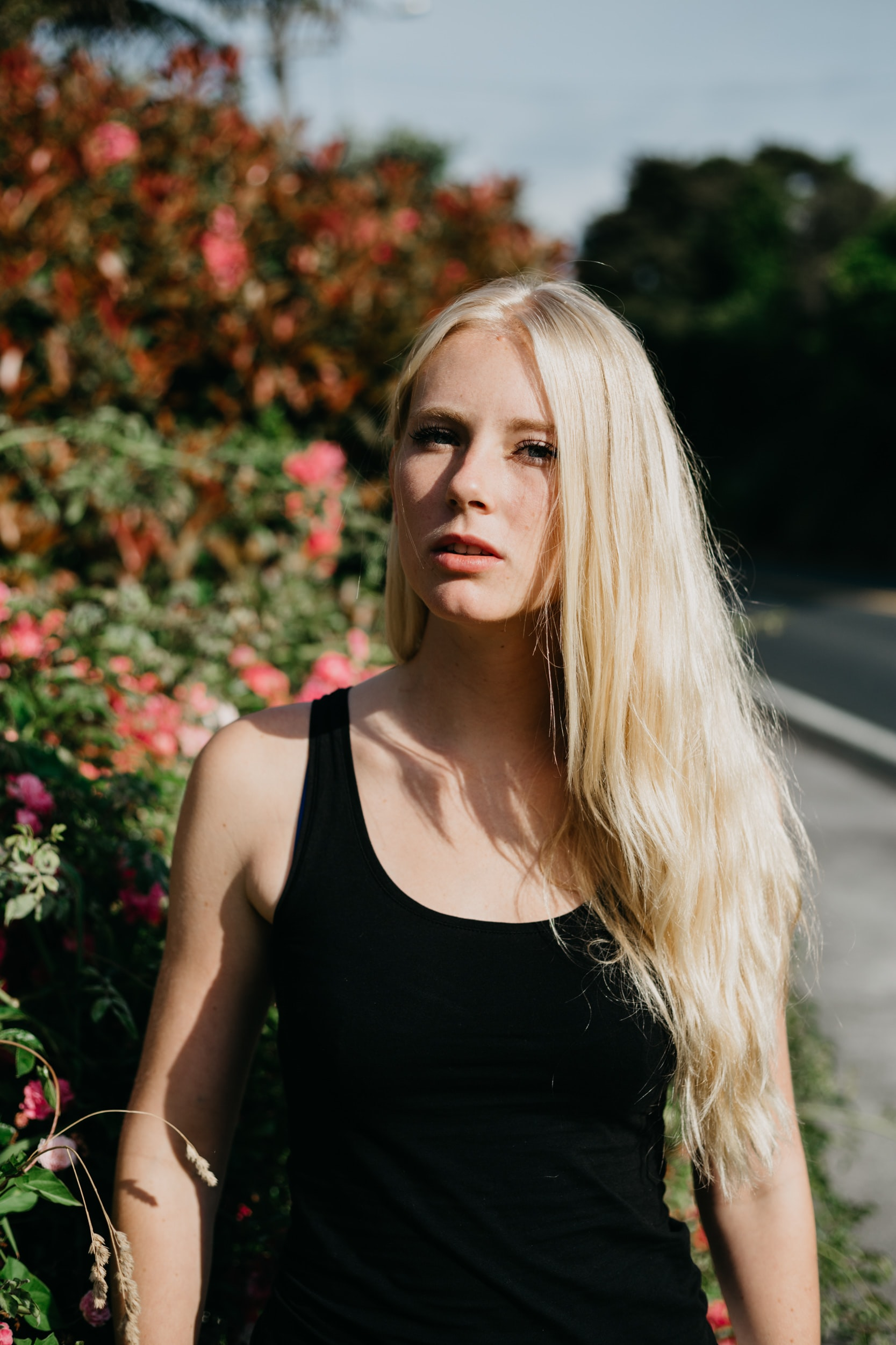 woman wearing black tank top in shallow focus photography