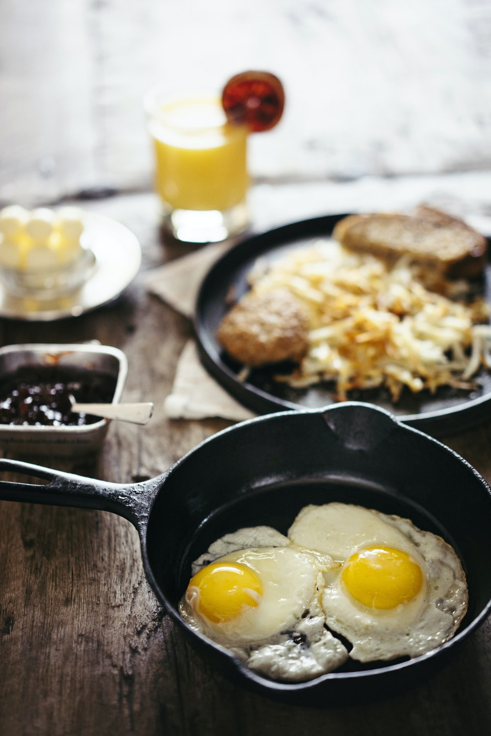 two fried eggs on skillet