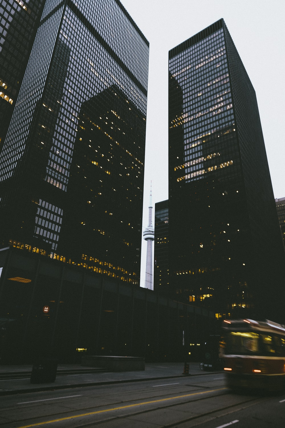 two black city buildings during daytime in time lapse photography