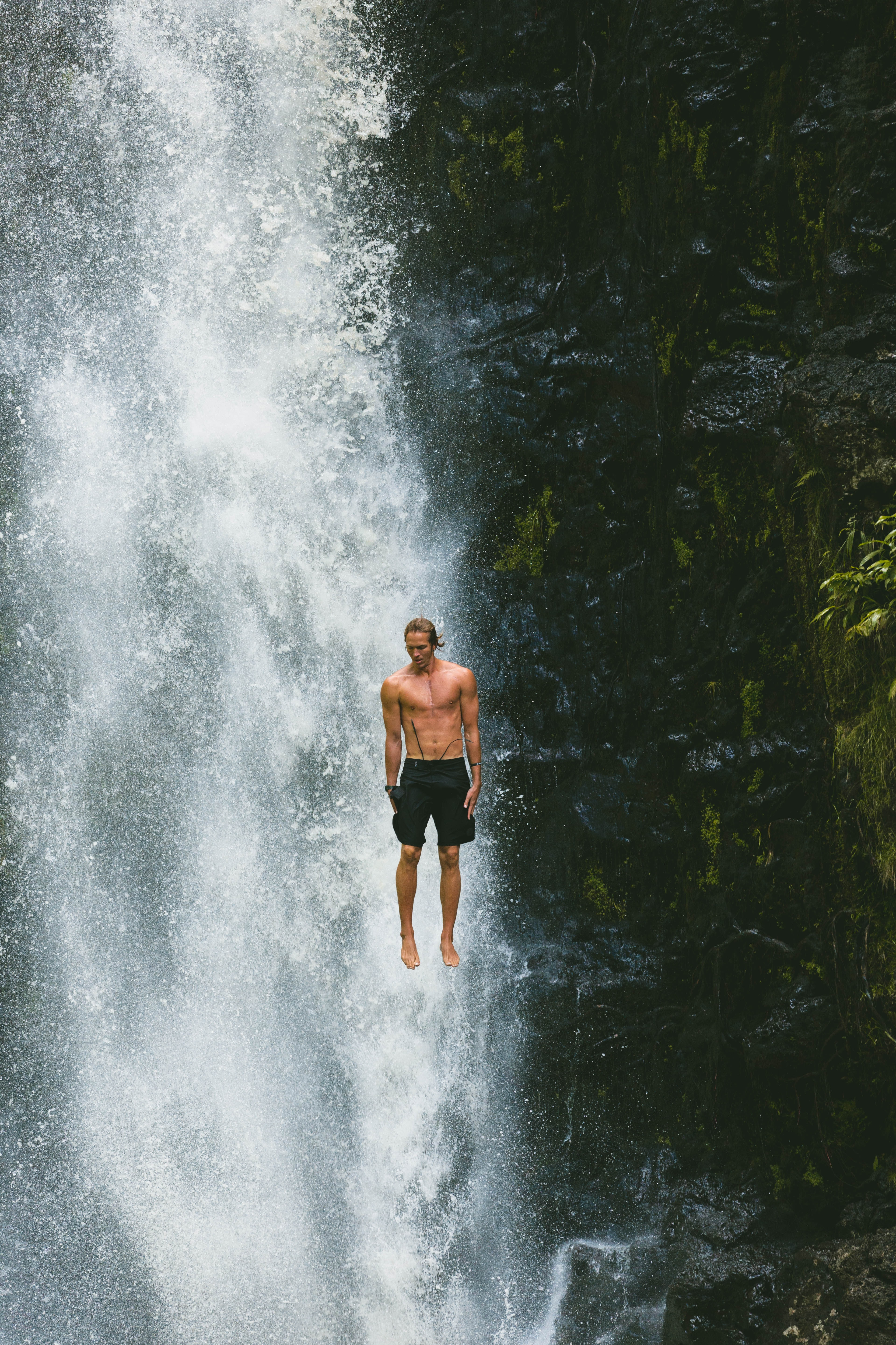 man jumps in waterfalls