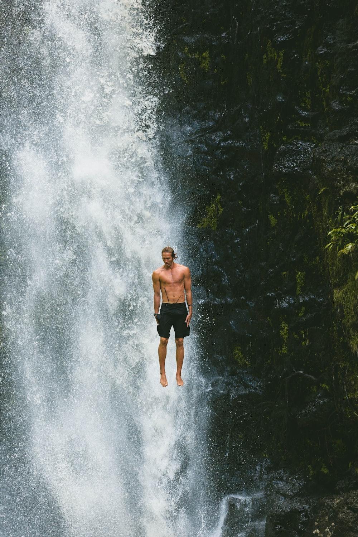 man jumps in waterfalls