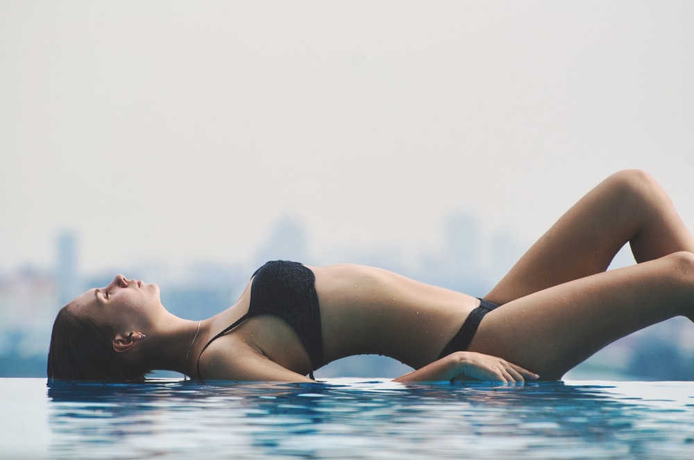 woman lying on pool