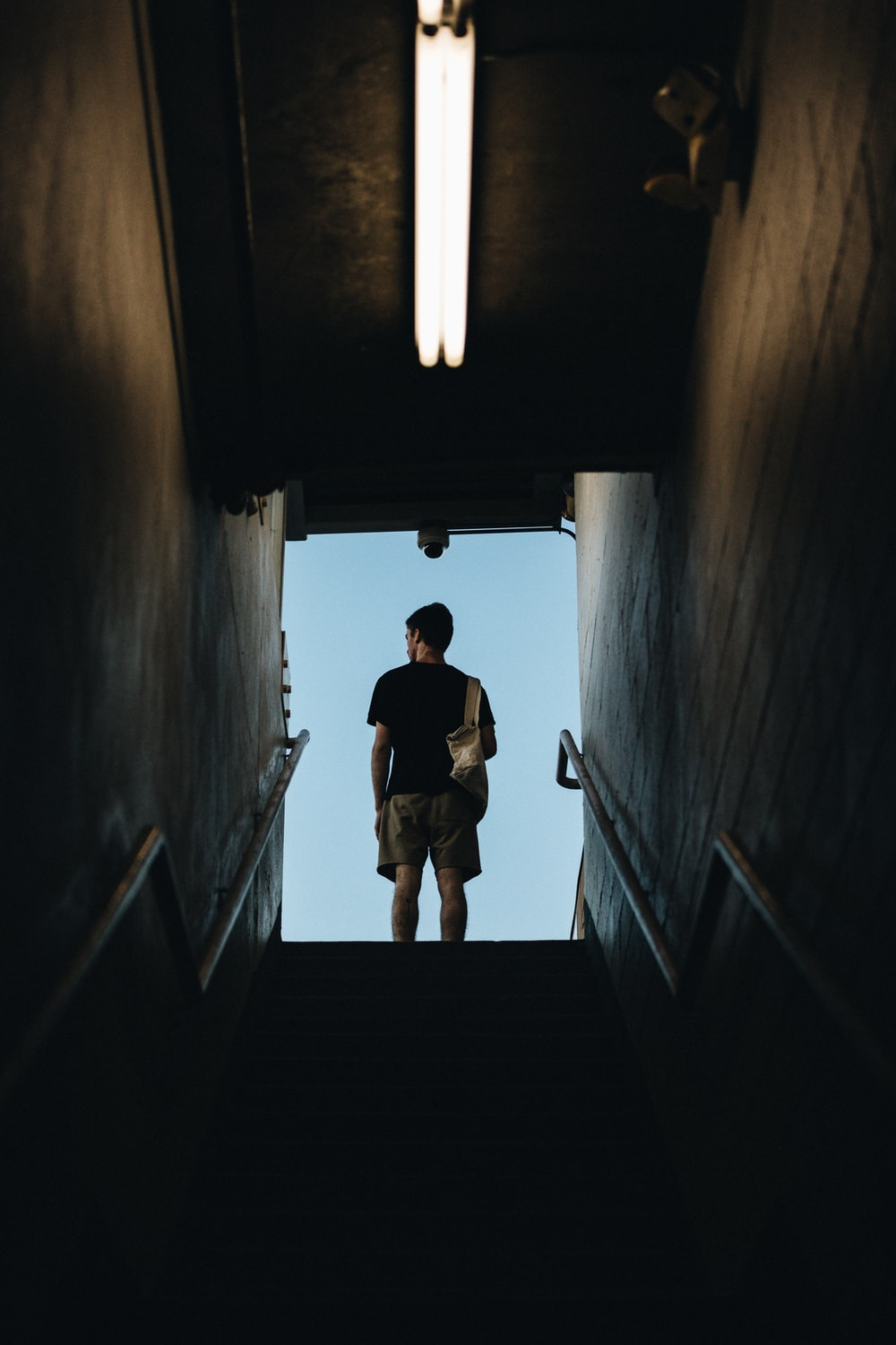 man standing on stair