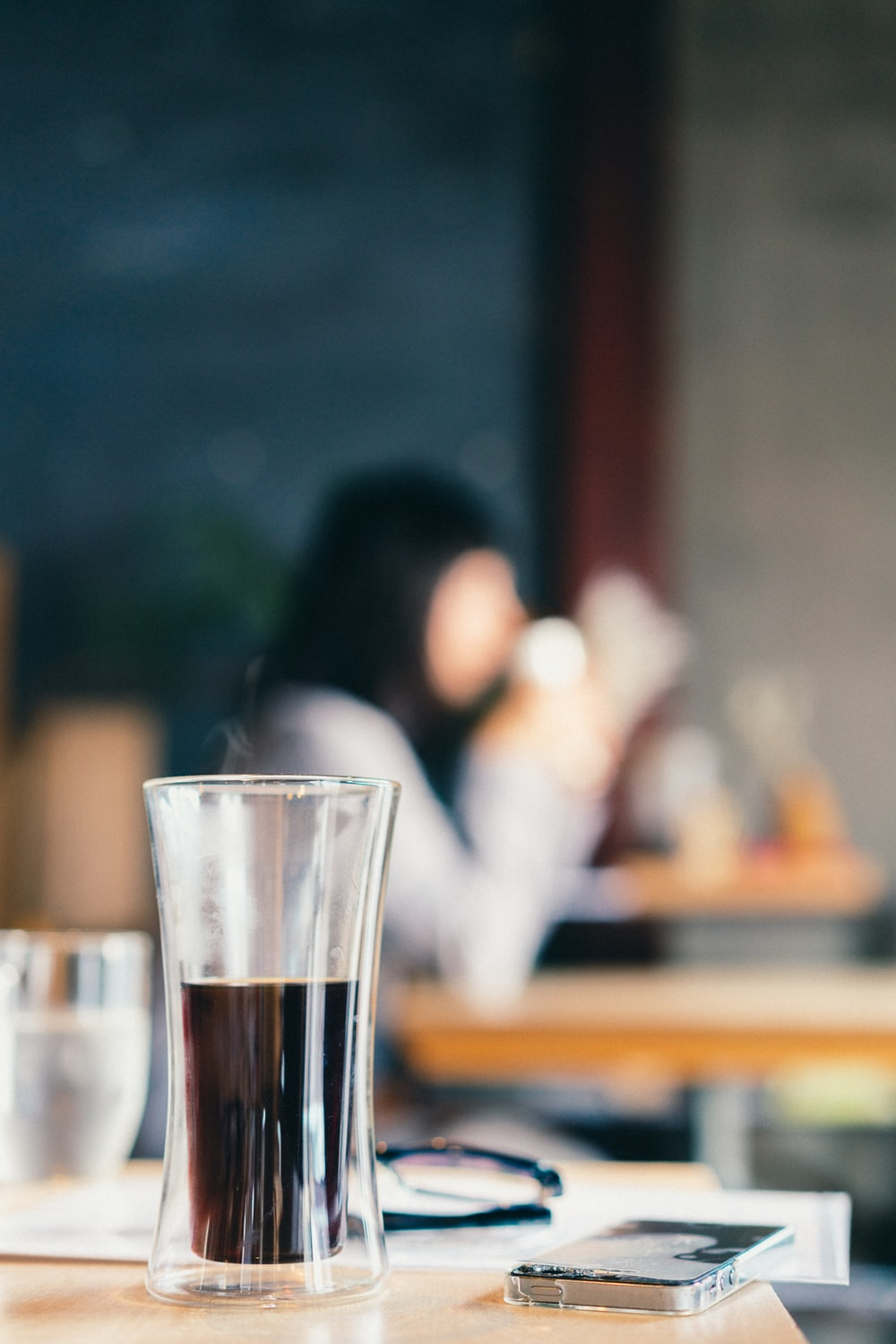 shallow focus photo of drinking glass with liquor
