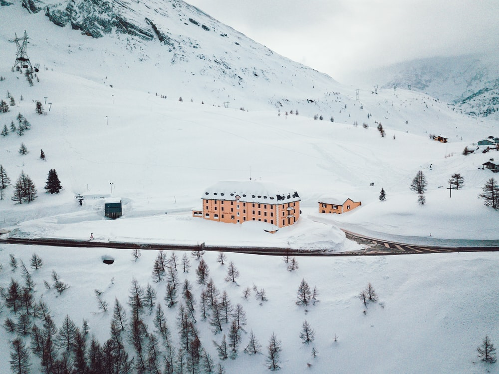 building on snowy mountain during daytime