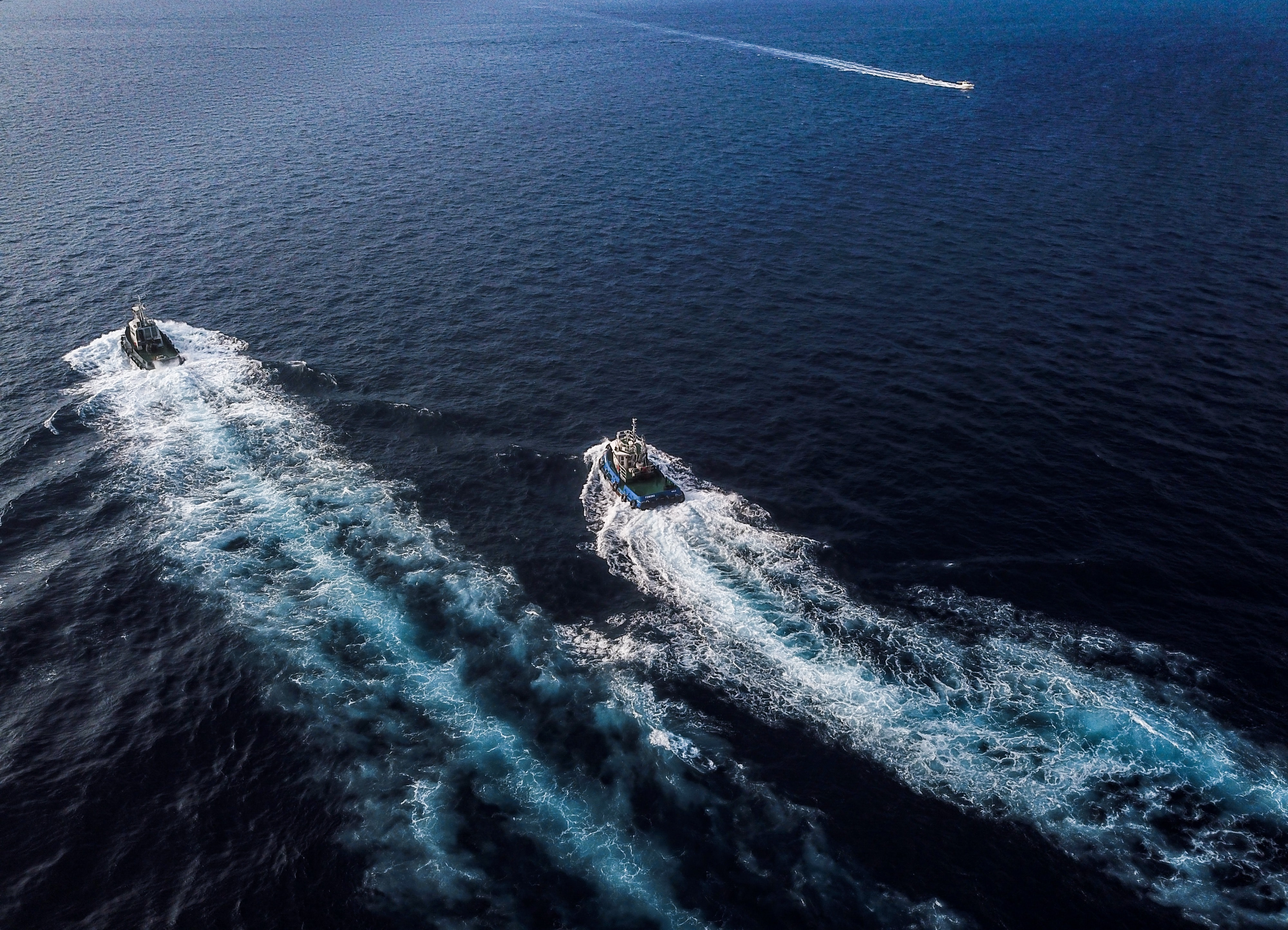 aerial photography of two boats at sea