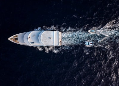 aerial photo of white yacht boat zoom background