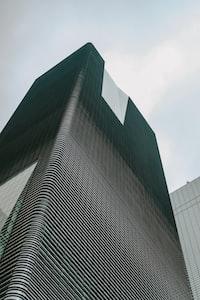 ground shot of black skyscraper