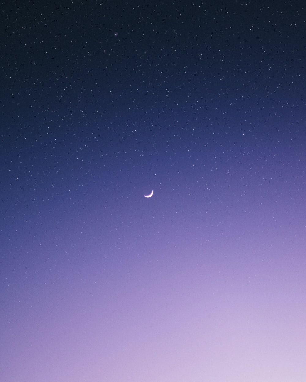 crescent moon surrounded by stars during night time