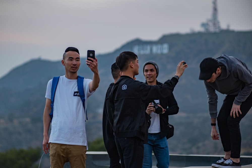 people taking photo on building