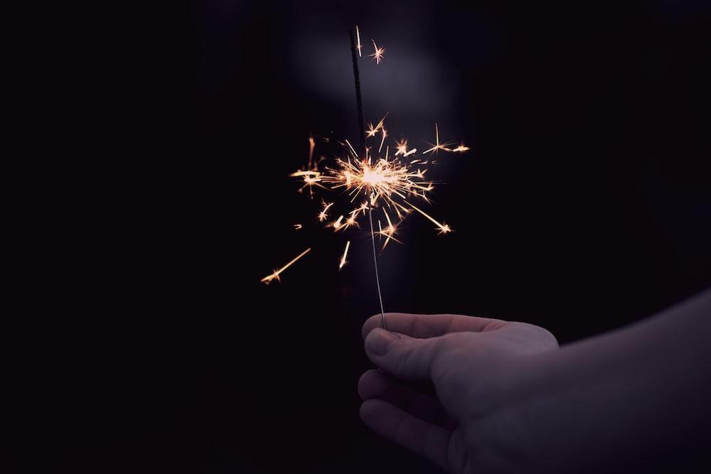 person holding a sparkler