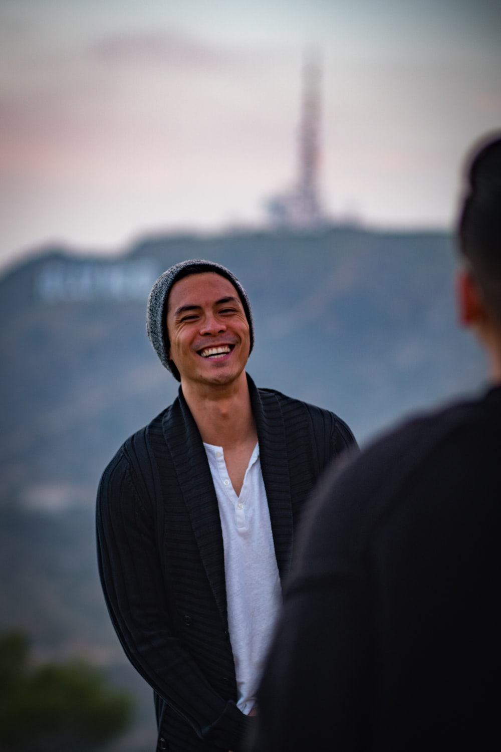 man smiling while facing other person