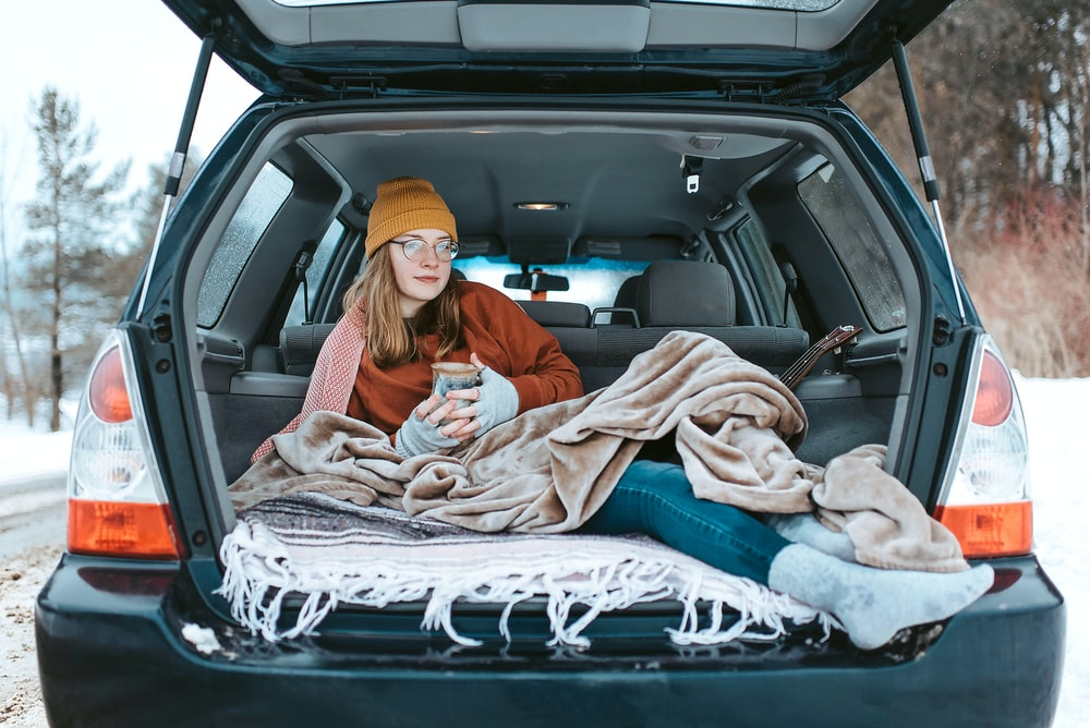 woman lying down on car compartment