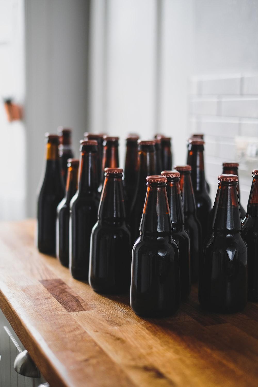 black glass bottles on table top
