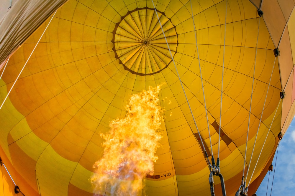 low angle photography of yellow hot air balloon