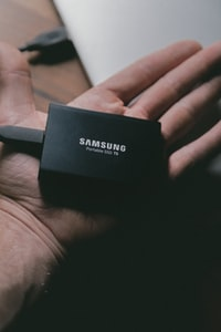 Samsung portable T5 SSD on person's hand