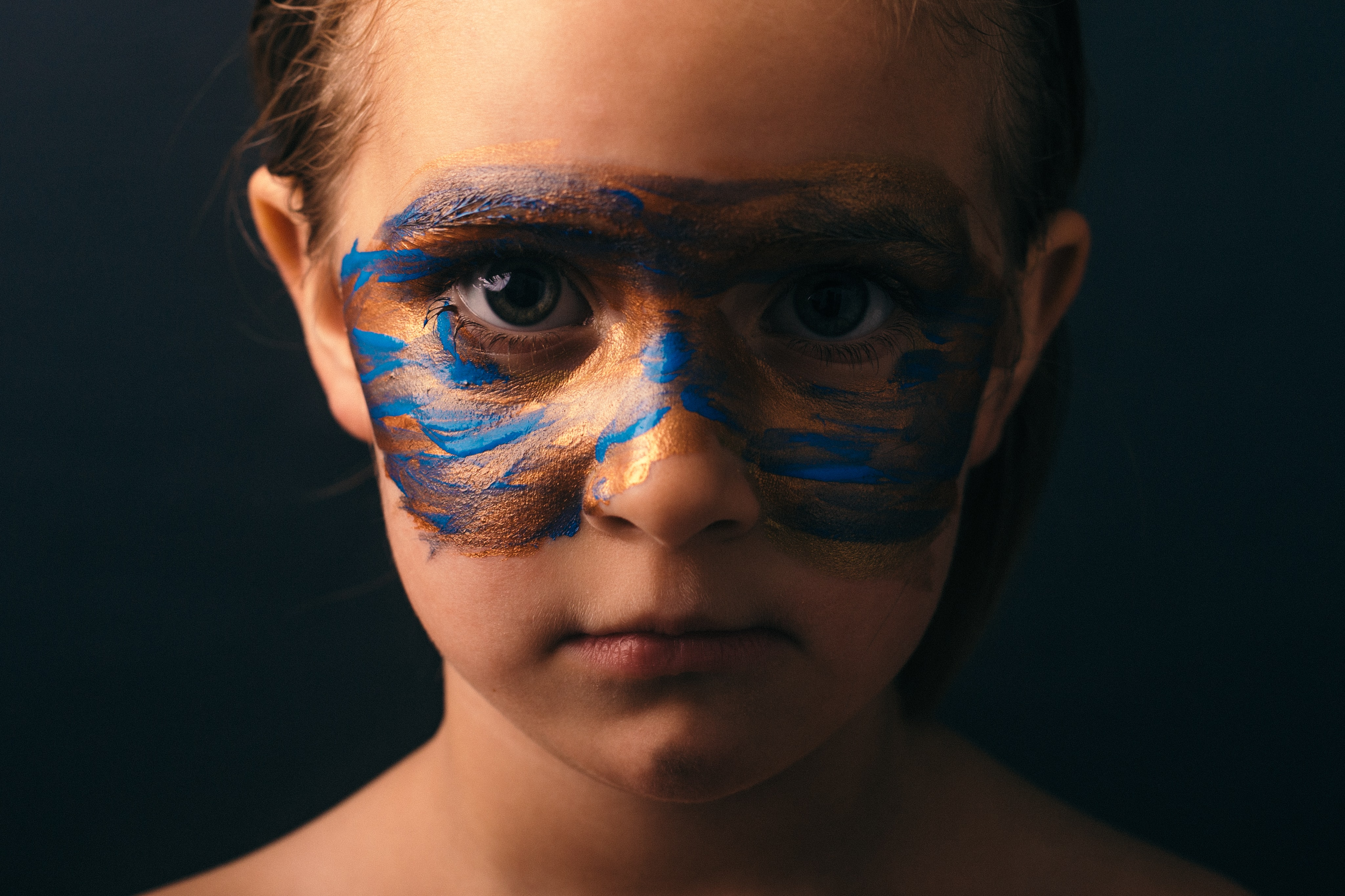 close up photo of girls with face paint