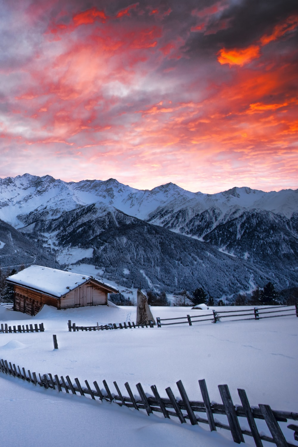 snow covered mountain photography during sunset
