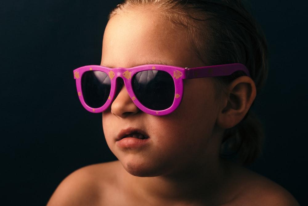 girl wearing pink framed sunglasses