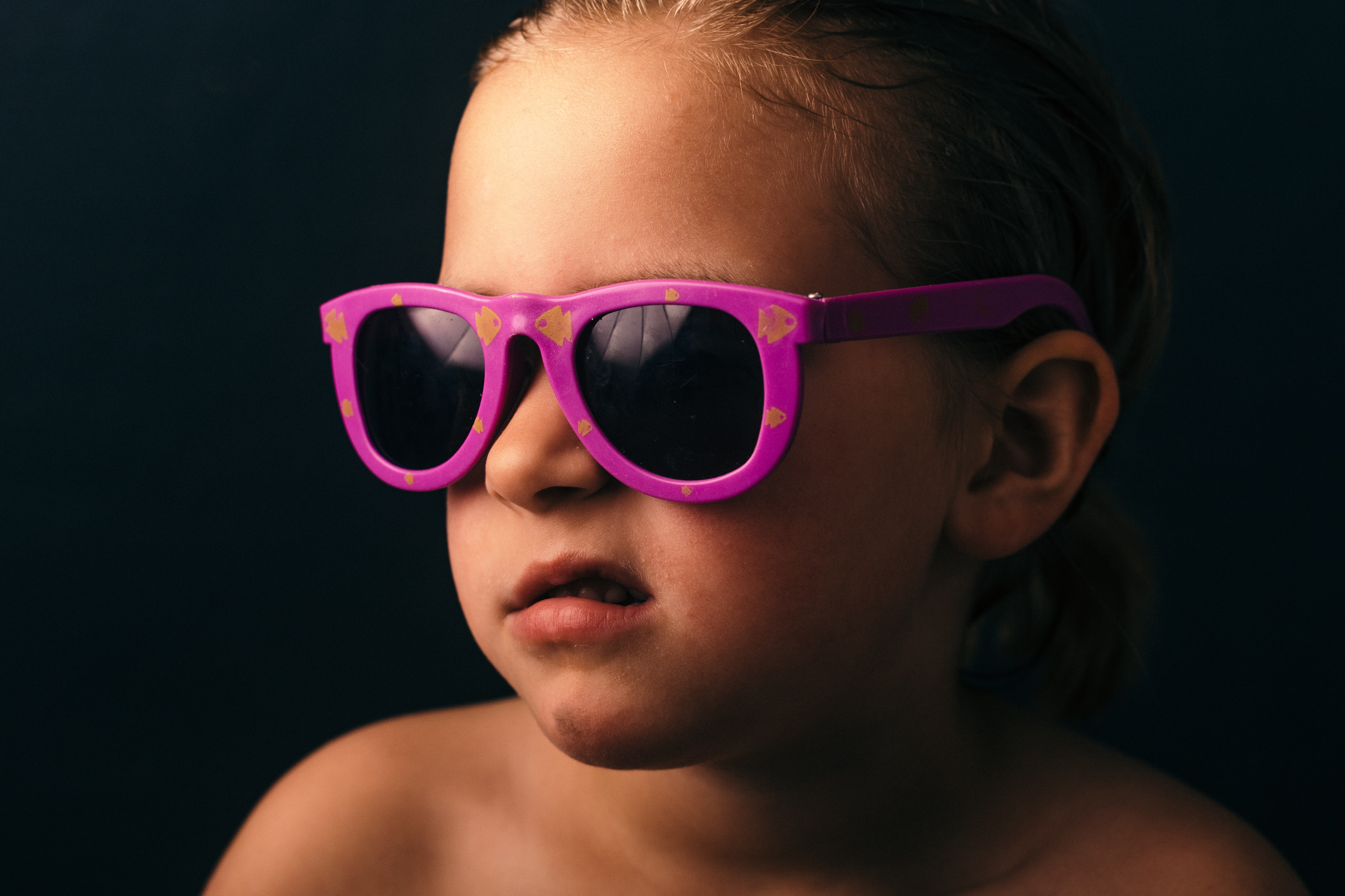 girl wearing pink framed sunglasses