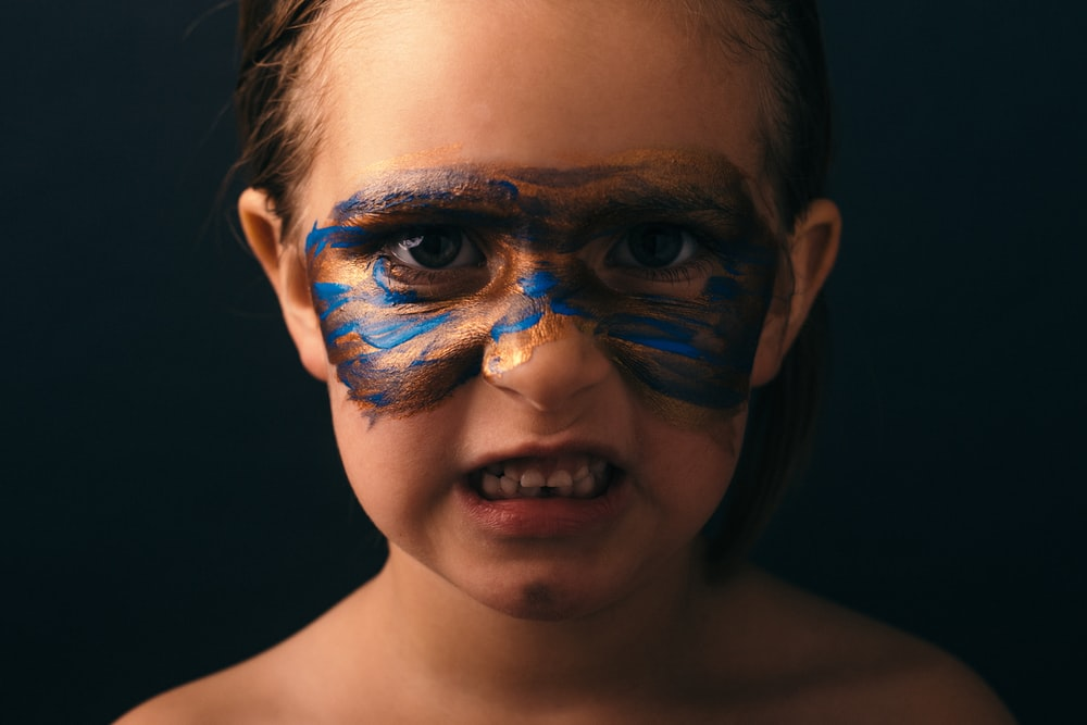 girl wearing face paint portrait