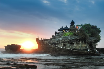 black building on gray rock hill bali zoom background