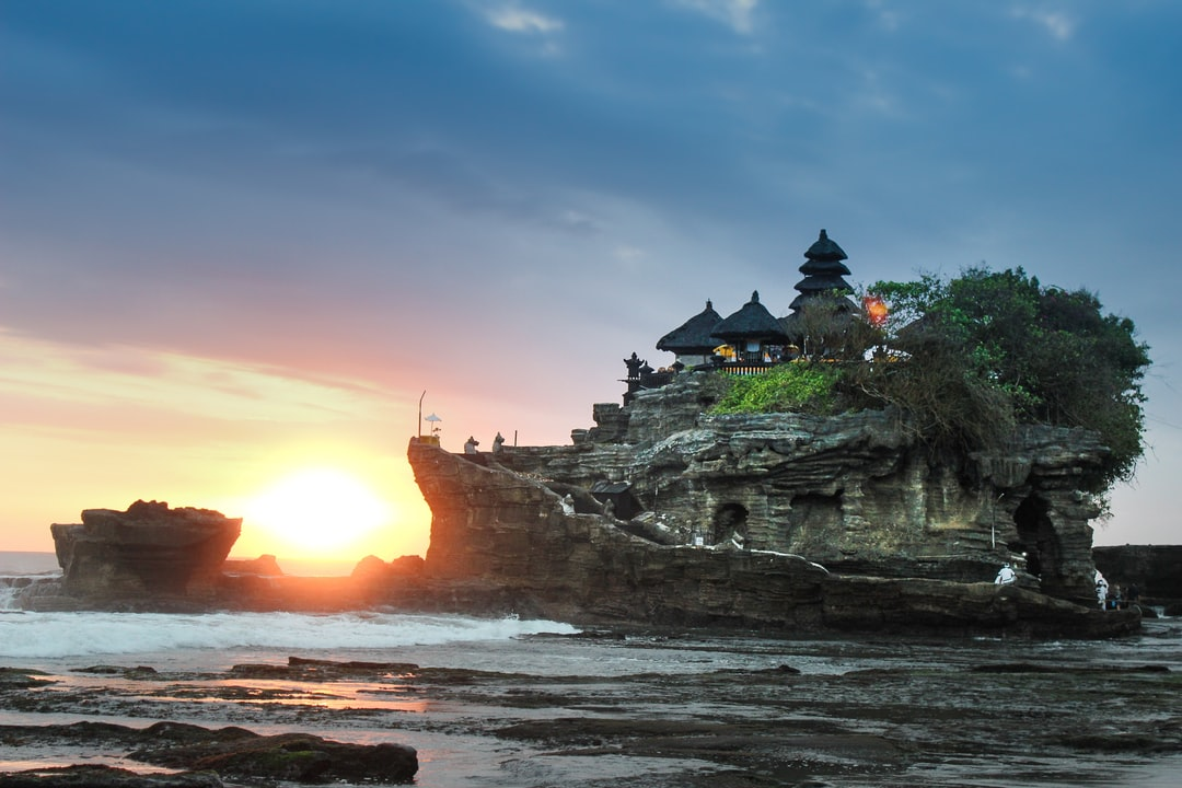 black building on gray rock hill in Bali Indonesia