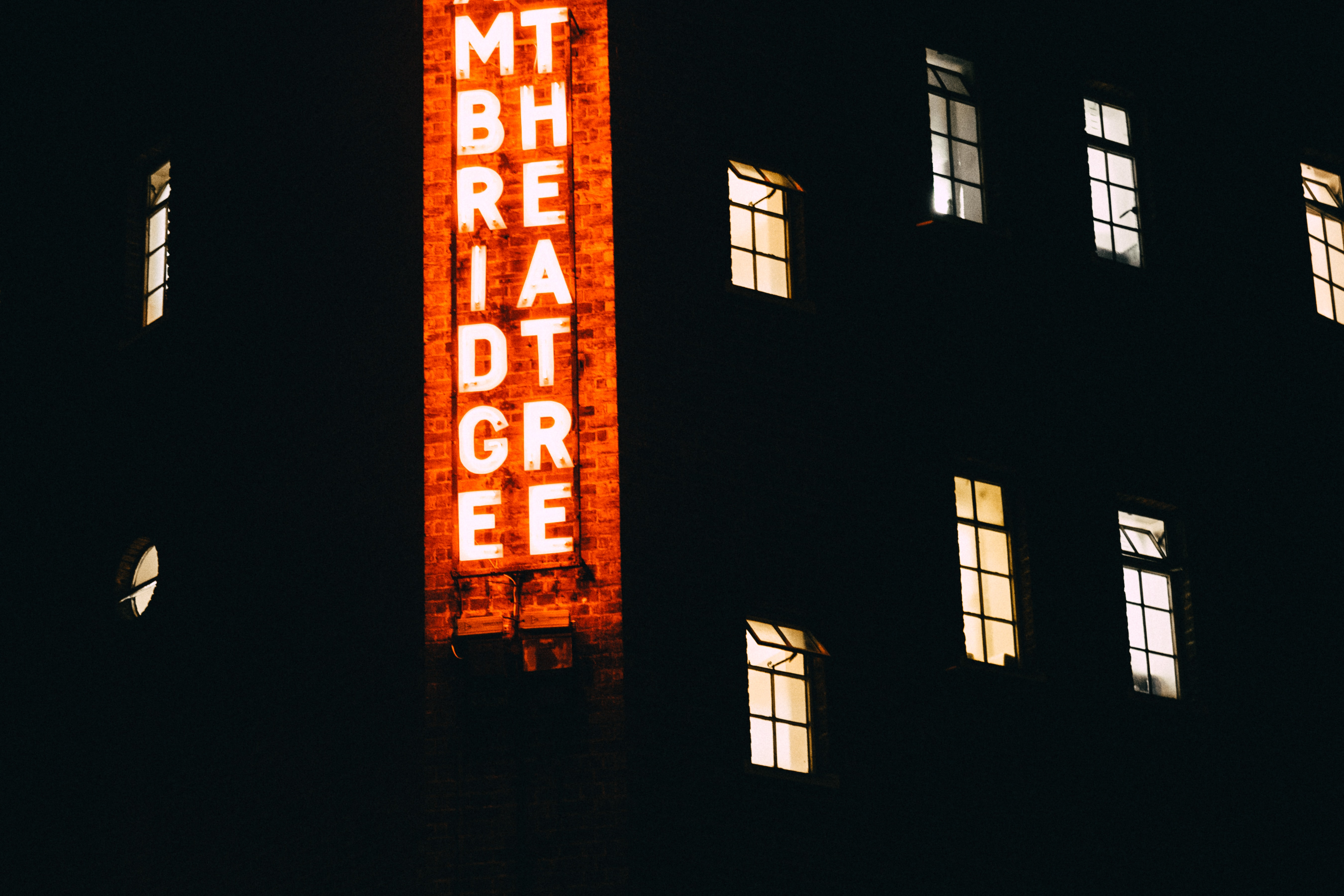 lighted building with signboard