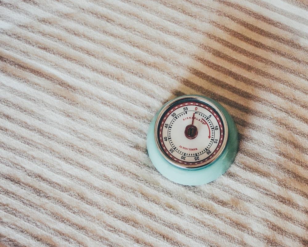 round teal gauge on white textile