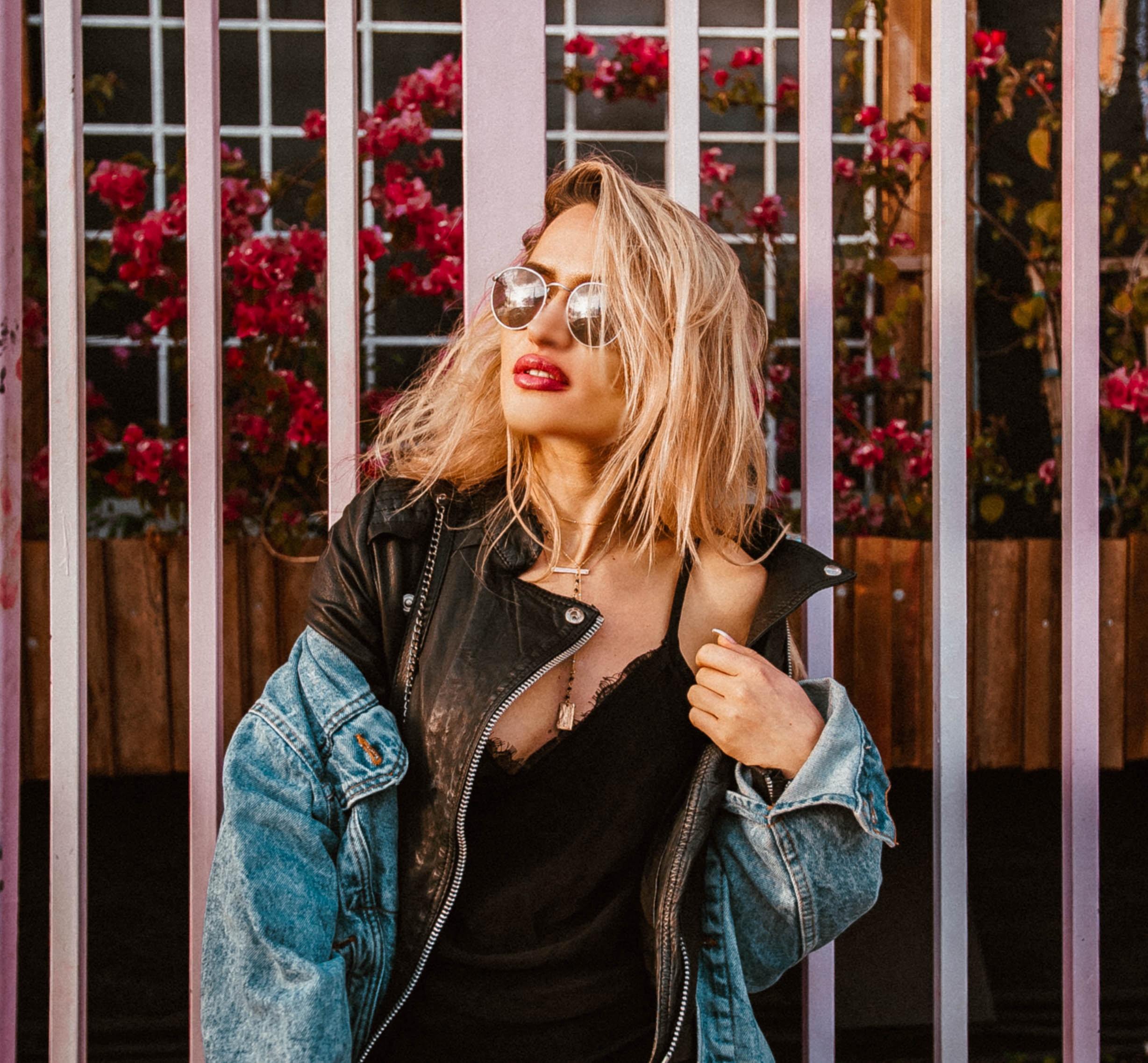 woman wearing sunglasses and black spaghetti strap shirt