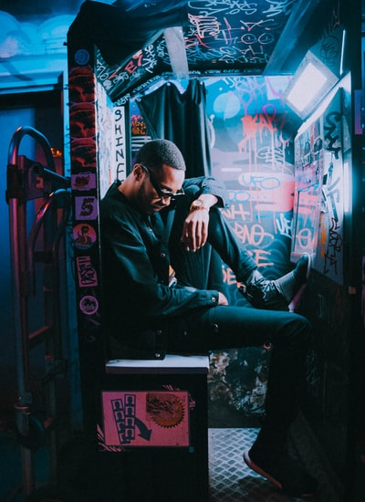 man sitting on chest inside room