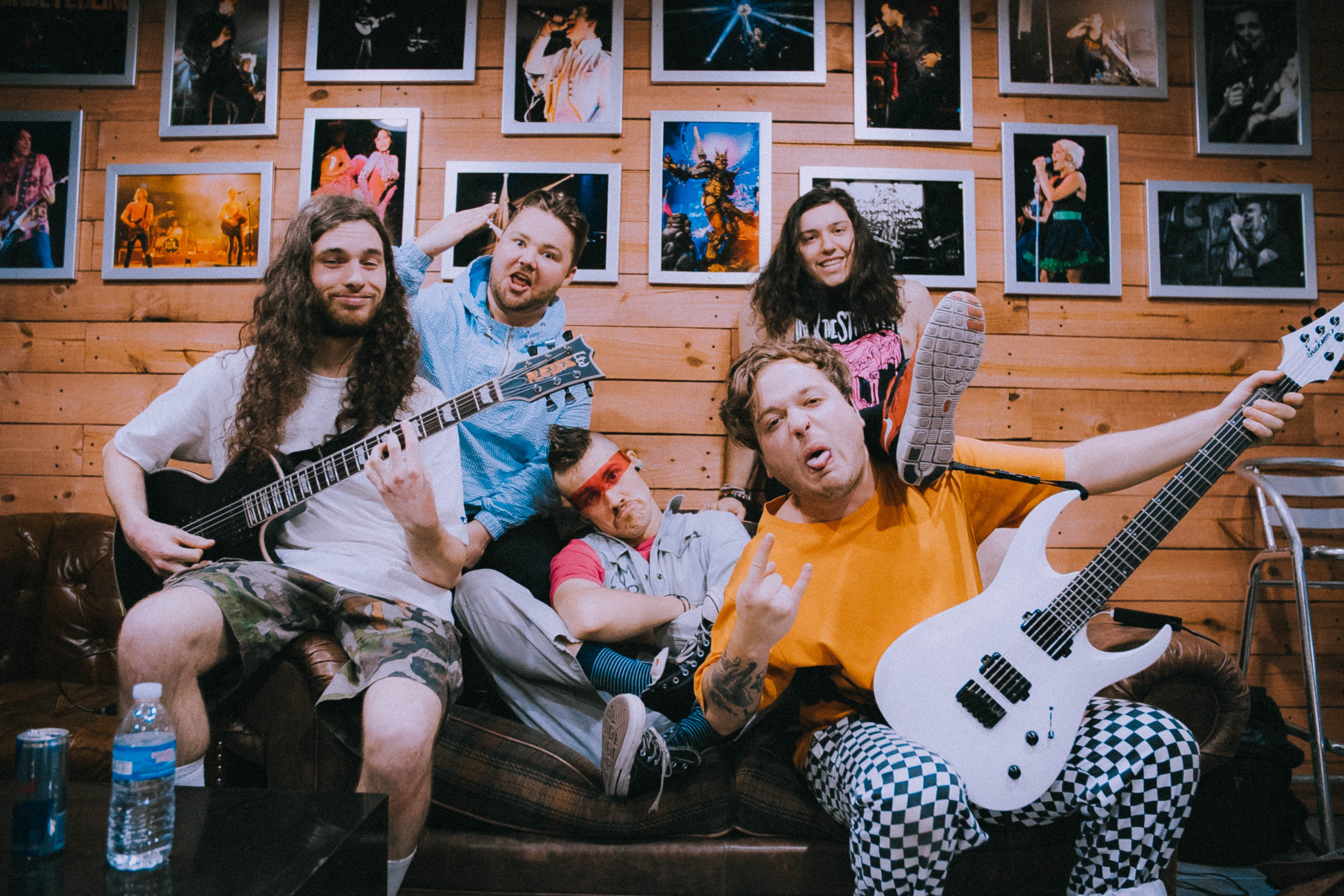 band taking groufie picture on brown sofa
