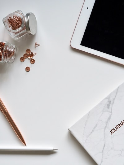 Rose gold and white desktop items